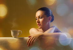 Aromatic coffee. Woman with an aromatic coffee Stock Photos