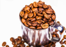 Aromatic coffee beans in  iron cup Stock Photos