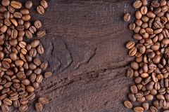 Aromatic coffee beans on an old wooden table. Top view with copy for text. Creative background. Stock Photo