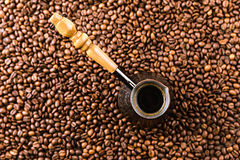 Aromatic coffee beans and turk with beverage Stock Image