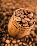 Aromatic coffee beans in a wooden cup Royalty Free Stock Image