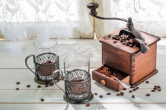 Aromatic coffee and old grinder Royalty Free Stock Photography