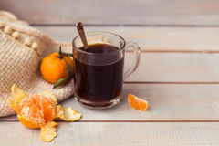 Aromatic coffee, tangerine on a white wooden background. Stock Image