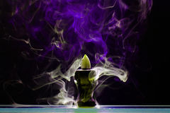 Aromatic cone smoldering in a ceramic stand Royalty Free Stock Photo