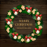Aromatic Decorated Christmas Wreath on Wooden Door. Evergreen wreath on door. Christmas wreath of Xmas tree branches with garlands, orange and spices on wooden Royalty Free Stock Photos