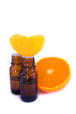 Aromatic essence oil and fresh orange segment Stock Photos