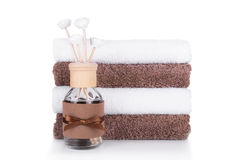 Aromatic essences and a stack of towels. Close-up Royalty Free Stock Photography