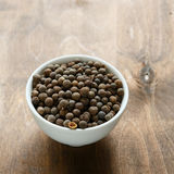 Aromatic fragrant black pepper in a bowl Royalty Free Stock Photography