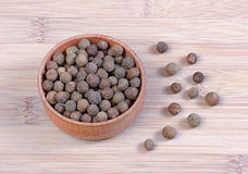 Aromatic fragrant black pepper in a bowl Royalty Free Stock Photos