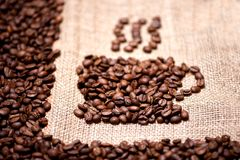 Aromatic and fresh coffee beans on vintage cloth. Aromatic and fresh coffee beans on vintage background Stock Photo