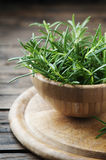 Aromatic fresh rosemary on the wooden table Royalty Free Stock Images