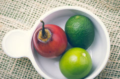 Aromatic garden-fresh tree tomato and limes in Stock Image