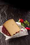 Aromatic gourmet cheese with rose petals Stock Images