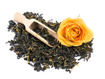 Aromatic green tea, yellow rose and wooden shovel Stock Images