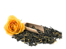 Aromatic green tea, yellow rose and wooden shovel Stock Photo