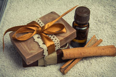 Aromatic handmade soaps with oils and cinnamon on a soft towel Stock Photos