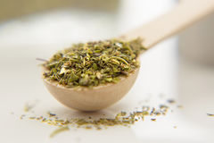 Aromatic herbs are in the small spoon close-up. Royalty Free Stock Photos