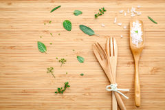 Aromatic herbs and spices green mint ,fennel ,oregano, sage,lem. On thyme and peppermint with fork and sea salt on bamboo cutting board royalty free stock photography