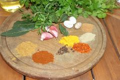 Aromatic herbs spices and kitchen condiments. Aromatic herbs from the organic garden and spices for cooking Royalty Free Stock Images