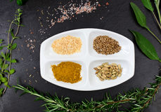 Aromatic herbs and spices over slate sheet Stock Photo