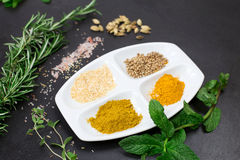Aromatic herbs and spices over slate sheet Stock Photos