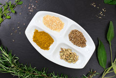Aromatic herbs and spices over slate sheet Stock Images