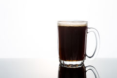 Aromatic hot black coffee in a transparent glass Royalty Free Stock Photo