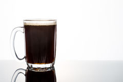 Aromatic hot black coffee in a transparent glass Stock Photos