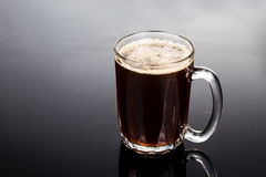 Aromatic hot black coffee in a transparent glass Stock Photography