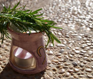 Aromatic lamp with  branches of rosemary. Royalty Free Stock Photos