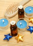 Aromatic oil and candles Royalty Free Stock Photos