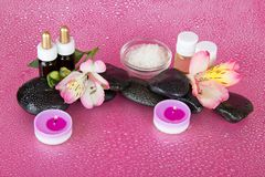 Aromatic oil, candles and stones Stock Photo