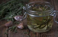 Aromatic oil of rosemary, thyme and garlic royalty free stock photos