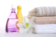 Aromatic oil, shampoo and towel Stock Image