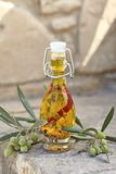 Aromatic olive oil Stock Images