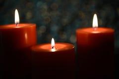 Aromatic orange candle, bokeh background Royalty Free Stock Photo