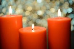 Aromatic orange candle, bokeh background Royalty Free Stock Image