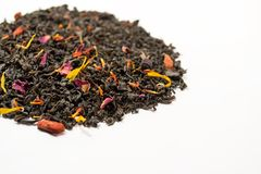 Aromatic, pungent, black tea with dry berries and flowers. Aromatic, pungent, black tea with dry berries and flowers on white background royalty free stock photography