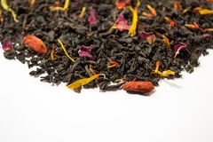 Aromatic, pungent, black tea with dry berries and flowers. Side view.  stock photography