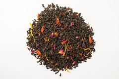 Aromatic, pungent, black tea with dry berries and flowers. Top view.  royalty free stock photo