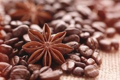 Aromatic roasted coffee beans and anis or badian background close up stock photography