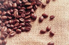 Aromatic roasted coffee beans and anis or badian background close up stock images