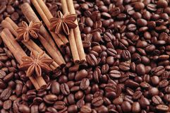 Aromatic roasted coffee beans and anis or badian, sticks of natural cinnamon on background close up.  stock photos