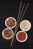 Aromatic Selection. Frankincense, myrrh, sandalwood, pot pourri and incense sticks over bamboo background Stock Photos
