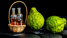 Aromatic spa concept of bergamot fruits and  bottles essential o Stock Images