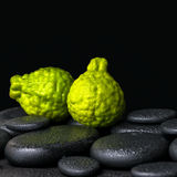 Aromatic spa concept of bergamot fruits on zen basalt black ston Royalty Free Stock Photography