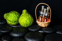 Aromatic spa concept of bottles essential oil in basket, bergamo Royalty Free Stock Photos