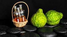 Aromatic spa concept of bottles essential oil in basket, bergamo Stock Photos