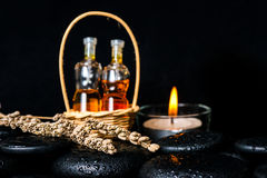 Aromatic spa concept of bottles essential oil in basket, dried l Royalty Free Stock Photo
