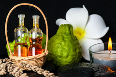Aromatic spa concept of bottles essential oil in basket, flower, Stock Images